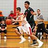 Tyngsboro player #2-Christian Beck, drives past Gardner player #44_Jovonn Calhoun, to the basket for a score, Tyngsboro won 63~26. SUN/David H. Brow