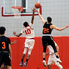 Tyngsboro player #10-Elcharis Kamuanga flies up for a rebound with Gardner player #25-Jacob Clancy, in this game won by Tyngsboro 63~26. SUN/David H. Brow