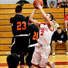 Tyngsboro #2-Christian Beck gets past Gardner blocks from #23-Cory Zollo and #24-Zachary Valliere for a lay-up. SUN/David H. Brow
