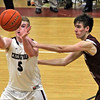 Chelmsford #5-Jack Slattery passes off the ball as Westford #10-Benjamin Lawrence moves in on him, game was won by Westfrod 66~58.SUN/David H. Brow