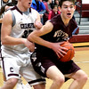 Westford #25-Jake Barisano grabs the ball as Chelmsford player #32-Peter Caruso moves in.  SUN/David H. Brow