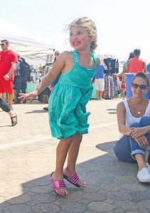 Faith Germano, from Clifton, dancing. The 2019 Lobster Fest in Bradley Beach, NJ on 8/31/19. [DANIELLA HEMINGHAUS]