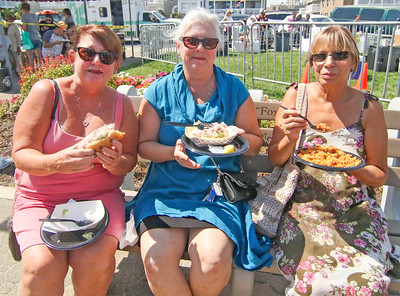 [l-r]: Moe Keane, from Ocean Grove; Barbara Sclafani, from Whiting; and Marita De Carlo, from Toms River. The 2019 Lobster Fest in Bradley Beach, NJ on 8/31/19. [DANIELLA HEMINGHAUS]