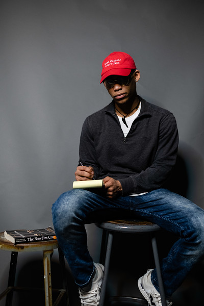 """Wearing a hat that says """"Make America Great Once,"""" a play on President Donald Trump's """"Make America Great Again"""" hat, sophomore in economics and pre-law Bradley Richards tells about what inspires him to write and share his poetry. (Olivia Bergmeier 