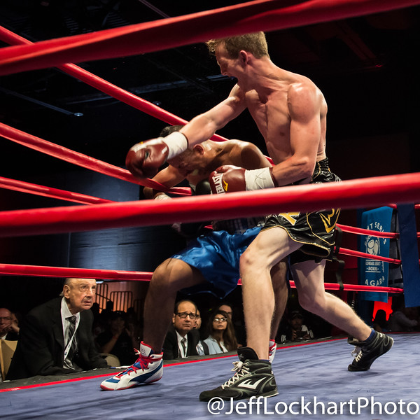 Bradley Wilcox (pro debut, black) of Hamilton, Ontario with second round TKO over Arturo Garcia Lujan