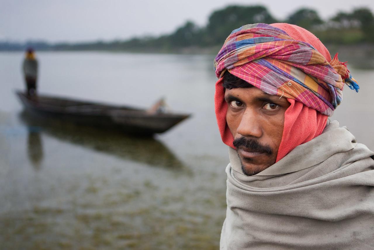 Fishermen and their boat. Near Tezpur. Assam.