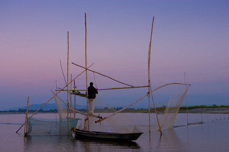 Checking the net. Near Tezpur. Assam.