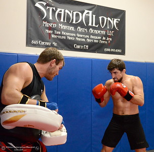 Brandon Ricetti of Chico, at right gets in some pad work with Ryan Hamilton at left as he trains at StandAlone Mixed Martial Arts in Chico, Calif. Wed. Aug. 8,  2018.  (Bill Husa -- Enterprise-Record)
