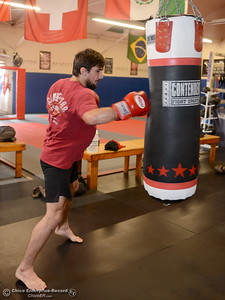 Brandon Ricetti of Chico works on a heavy bag as he trains at StandAlone Mixed Martial Arts in Chico, Calif. Wed. Aug. 8,  2018.  (Bill Husa -- Enterprise-Record)