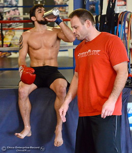 Brandon Ricetti of Chico gets some coaching from Owner Jason Pietz as he takes a short break while he trains at StandAlone Mixed Martial Arts in Chico, Calif. Wed. Aug. 8,  2018.  (Bill Husa -- Enterprise-Record)