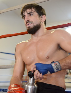 Brandon Ricetti of Chico takes a short break while he trains at StandAlone Mixed Martial Arts in Chico, Calif. Wed. Aug. 8,  2018.  (Bill Husa -- Enterprise-Record)