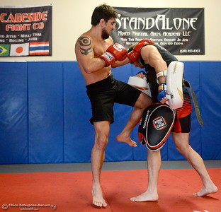 Brandon Ricetti of Chico, at left gets in some pad work with Ryan Hamilton at left as he trains at StandAlone Mixed Martial Arts in Chico, Calif. Wed. Aug. 8,  2018.  (Bill Husa -- Enterprise-Record)
