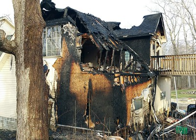 Damaged home after an April 19, 2016, house fire in Brandon Township. A dog was rescued. Photo by Dave Page / Special to The Oakland Press