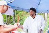 "KELLY FLETCHER, REFORMER CORRESPONDENT -- Justin Forbes, from ""Bacon Me Crazy"" in Hinsdale, serves up an order of candied bacon strips at Baconfest on Saturday"