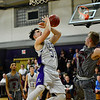 KRISTOPHER RADDER - BRATTLEBORO REFORMER<br /> Brattleboro's Eli Lombardi tries to get the offensive rebound during a Division 1 boys varsity basketball playoff game against Spaulding at Brattleboro Union High School on Wednesday, March 1, 2017.