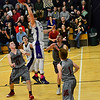 KRISTOPHER RADDER - BRATTLEBORO REFORMER<br /> Brattleboro's Eli Lombardi tries to drive the ball to the rim during a Division 1 boys varsity basketball playoff game against Spaulding at Brattleboro Union High School on Wednesday, March 1, 2017.
