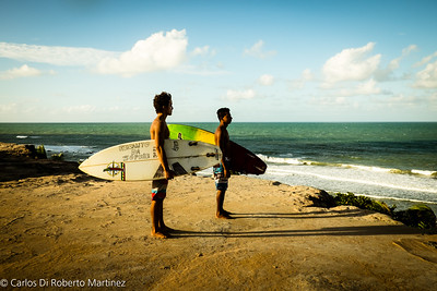 Surfers at Love Beach, near Pipa Beach, Rio Grande do Norte State