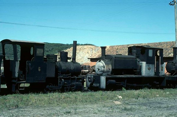 Imbituba Dock Company 0-4-0WT No 6 (left) & 0-6-0ST No 3, Imbituba docks, Brazil, 21 October 1976.  No 6 was built by Maffei (3868 / 1922) and has been preserved.  No 3 is a Manning Wardle product (works number 1915, built in 1916).  It is one of three Manning Wardle locos built for the Davington Light Railway in Kent, one of Britain's few metre gauge railways.  The railway served a munitions factory.  It closed after the end of the First World War and the locos were sold, all three going to Imbituba docks.  Photo by Les Tindall.