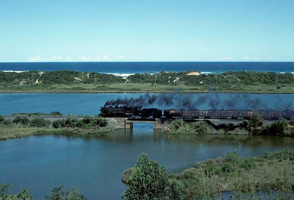 Dona Teresa Cristina Railway 2-10-4 No 304, near Imbituba, Brazil, 21 October 1976 3.  Crossing the lagoon just outside Imbituba.  Photo by Les Tindall.