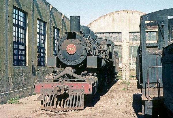 Dona Teresa Cristina Railway No 205, Tubarao, Brazil, 21 October 1976.  Stored Mallet 2-6-6-2 (Baldwin 74786 / 1950), now preserved.  The DTC had seven of these light Mallets, which were built new for the railway by Baldwin.  Photo by Les Tindall.