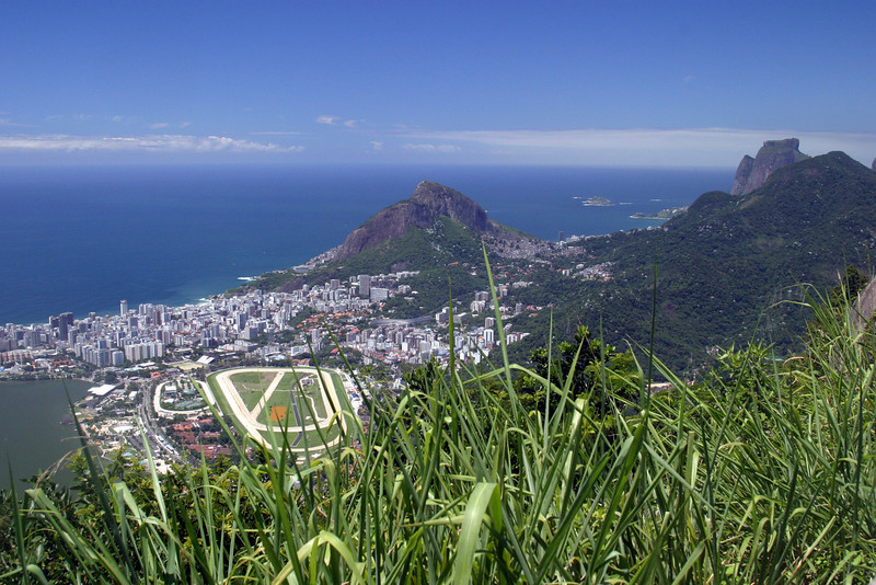 "View from the walk upto the Corcovado; syrise apartments of Leblon, of the ""Jockey Club"" horse track, rocky peaks of Dois Iramos Hill (center) and Pedra da Gavea Mountain (right) and Pedra Bonita Mountain (right foreground). 2004"