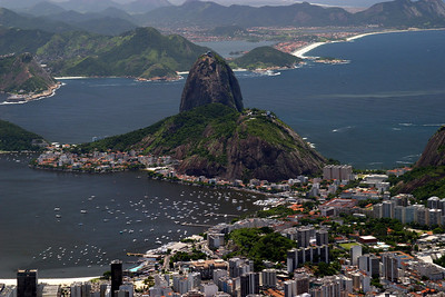 "Sugar Loaf mountain is one of Rio's most famous landmarks, gives a dramatic perspective on the natural beauty of the ""Cidade Maravilhosa"", as the city is known. From the top Sugar Loaf are wonderful views of the Guanabara Bay with the Botafogo beach to the North and Copacabana to the South, and  Rio proper in-between. 2004"