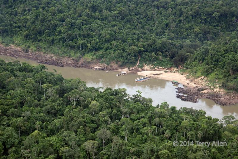 Macuco-boat-safari,-Iguazu-River-downstream-from-the-falls,-Argentina-side,-Brazil