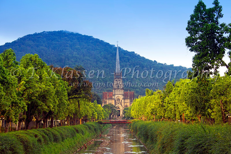 A canal with the Cathedral of Saint Peter of Alcântara in Petropolis, Brazil.