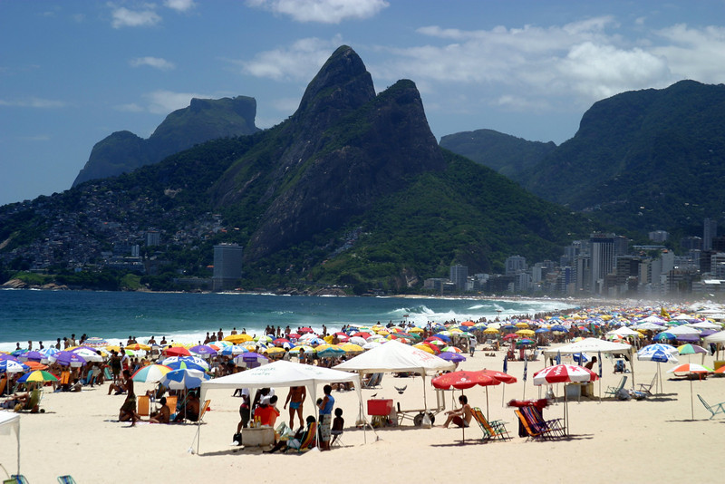 Ipanema beach, Favela's on the hill with Dois Iramos Hill in the background. Rio de Janeiro scenes