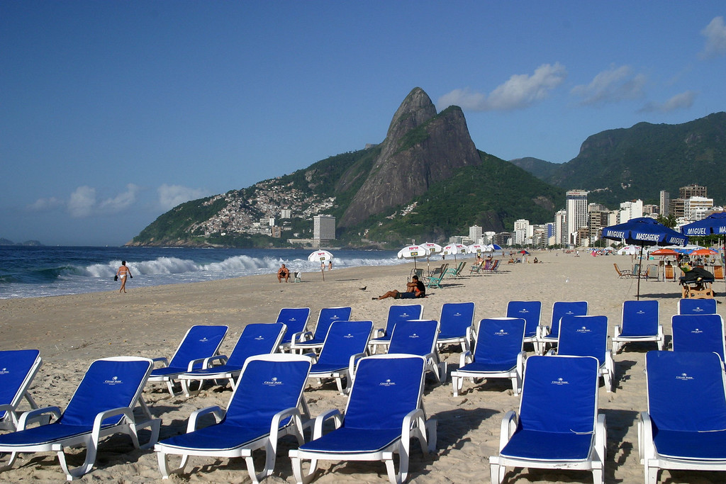 Impanema beach, Favela's on the hillside in the distance with Dois Iramos Hill Rio de Janeiro scenes