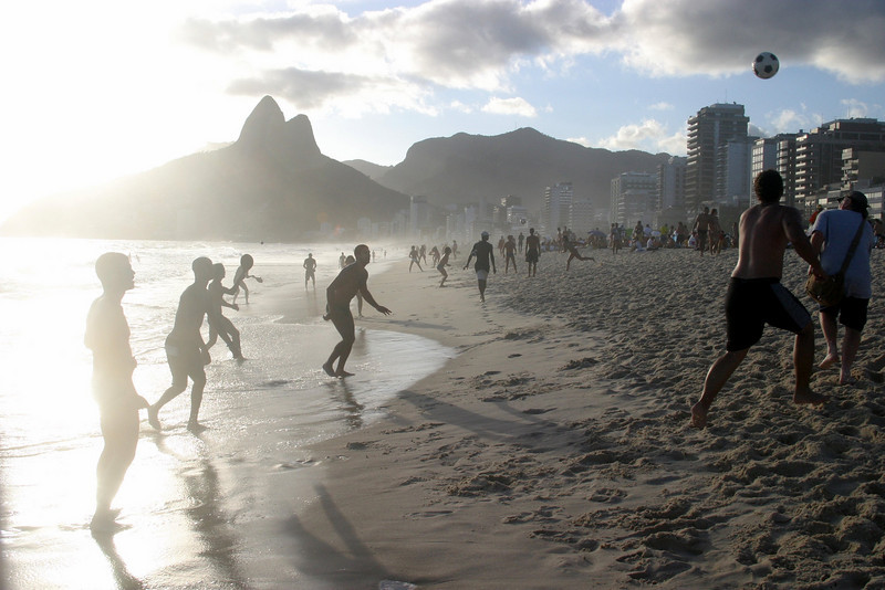 Playing football on the beach in late afternoon, Ipanema. Rio de Janeiro scenes