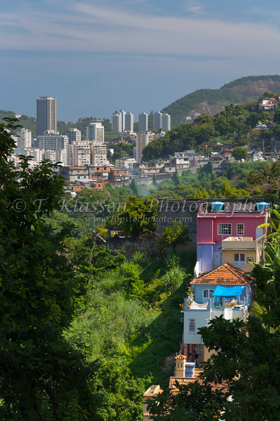 A group of colorful builidngs on a hillside from a viewpoint in the Santa Teresa district of Rio de Janeiro, Brazil.