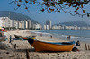 Fishing boats and nets at a small fishing village on Copacabana Beach in Rio De Janeiro, Brazil.