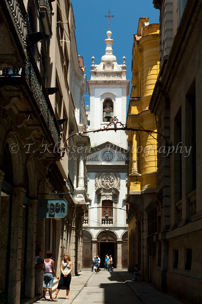 Narrow streets and an historic old colonial church  Lady of Lapa of the Comercial People church in downtown Rio De Janeiro, Brazil.