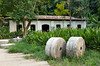Mill stones and an historic milling house in the botanical Gardens in Rio de Janeiro, Brazil.