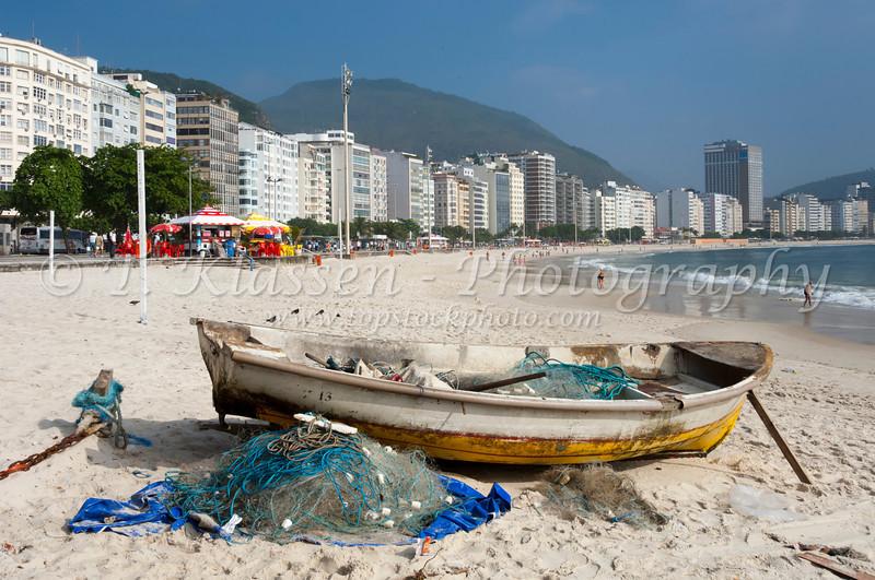 Fishing boats and nets at a small fishing village on Copacabana Beach in Rio De Janeiro, Brazil.