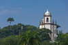 Tropical vegetation and the Nossa Senhora Gloria do Outeiro church in Rio De Janeiro, Brazil.