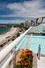 Views down Atlantica Ave. and Copacabana Beach with the swimming pool of the Luxor Regente Hotel in Rio De Janeiro, Brazil.