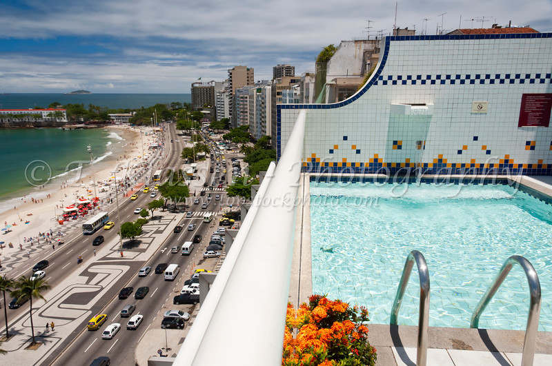 Views down Atlantica Ave. and Copacabana Beach with the swimming pool of the Luxor Regente Hotel in Rio De Janeiro, Brazil.