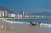 Fishermen with fishing boats and nets at a small fishing village on Copacabana Beach in Rio de Janeiro, Brazil.