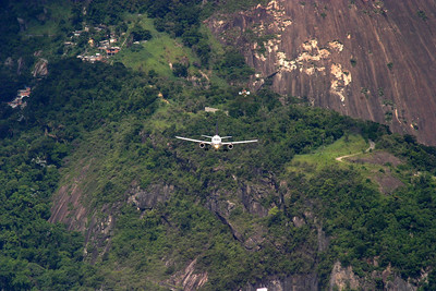 Seems to be coming straight for you, but these are great views from Sugar Loaf of a TAM plane on approach to Santos Dumont Airport (SDU), Rio de Janeiro.