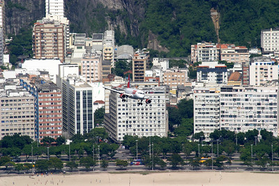 great views from Sugar Loaf of a  TAM plane on approach to Santos Dumont Airport (SDU), Rio de Janeiro.
