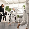 Students and instructors at the Paradigm Brazilian Jiu Jitsu warm up before starting class. SUN/David H. Brow