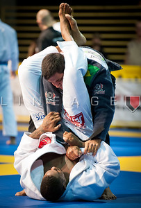 Stephen Hall (bottom) attempts to lock in the triangle choke.