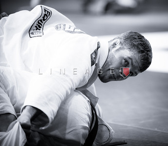 Flavio Almeida checks the score during his black belt match.