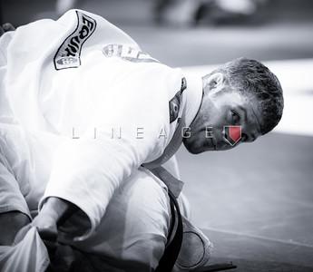 Flavio Almeida checks the score during his black belt match.