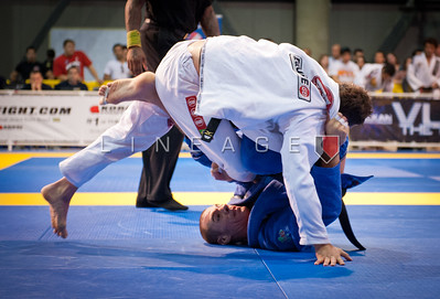 Raphael Lovato Jr. attempts to sweep Flavio Almeida in their gold medal match.