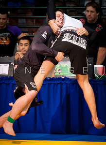 Flavio Almeida shoots for a takedown against Raphael Lovato Jr. in their gold medal match.