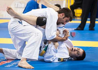 Andrew Bagatella (bottom) attempts the triangle choke on his opponent.