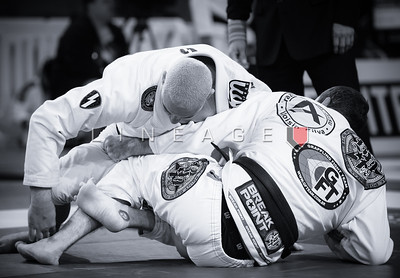 Rodrigo Medeiros (top) vs. Victor Barret Rodrigues in the Master 1 Male Black Ultra-Heavy Semi-Final